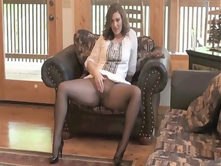brunette milf sits on her chair inside nylons and