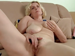 bushy older  with saggy breast masturbating by