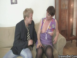 old woman spreads her feet for hard cock