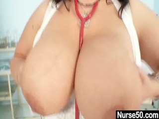 big tits lady doctor shows off her huge mellons