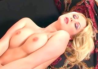 nice-looking babe masturbates in pink lingerie