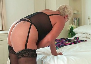 lewd granny in nylons rubs her wet crack