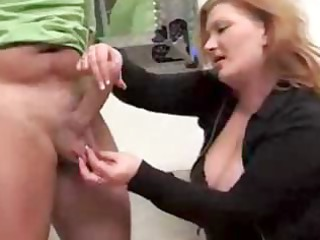 mature redhead gives these fellow a handjob