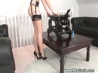 woman puts nylons on and drives a toy