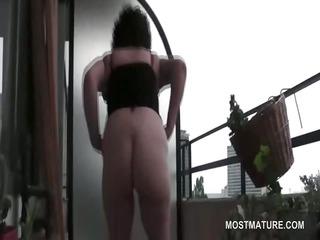 curly orgasm craving mature masturbates on terrace