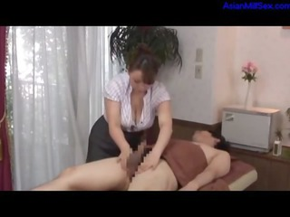 grown-up masseuse taking her large chest rubbed