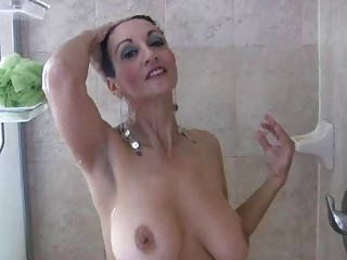 brunette woman with huge boobs plays  under bath