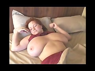 a redhead bbw woman with giant chest