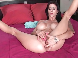 nasty giant titted milf whore pushing dildo into