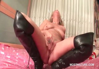 older in leather boots doing herself in daybed
